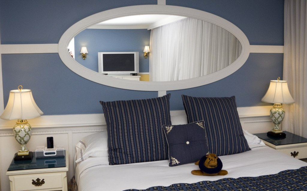 Modern bedroom with mirror behind the bed
