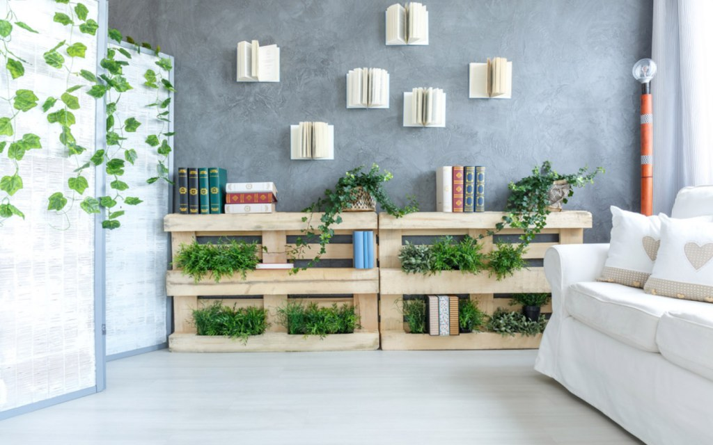 Bright living room with DIY pallet bookshelf