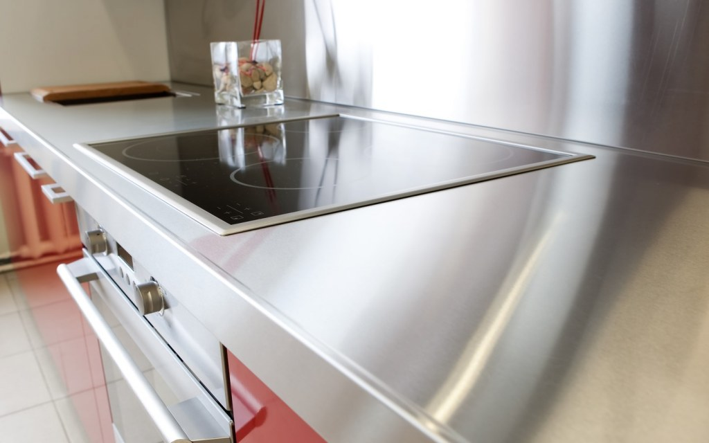 Stainless steel kitchen counter fitted with a stove on-top