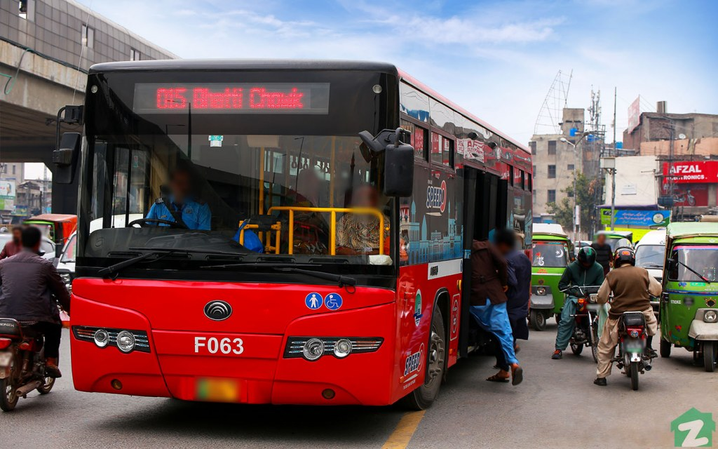 Feeder Buses Operate Amidst the Crowded Streets of Lahore