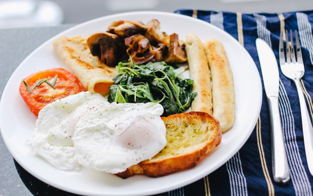 a Fancy Breakfast with poached eggs and fried meat
