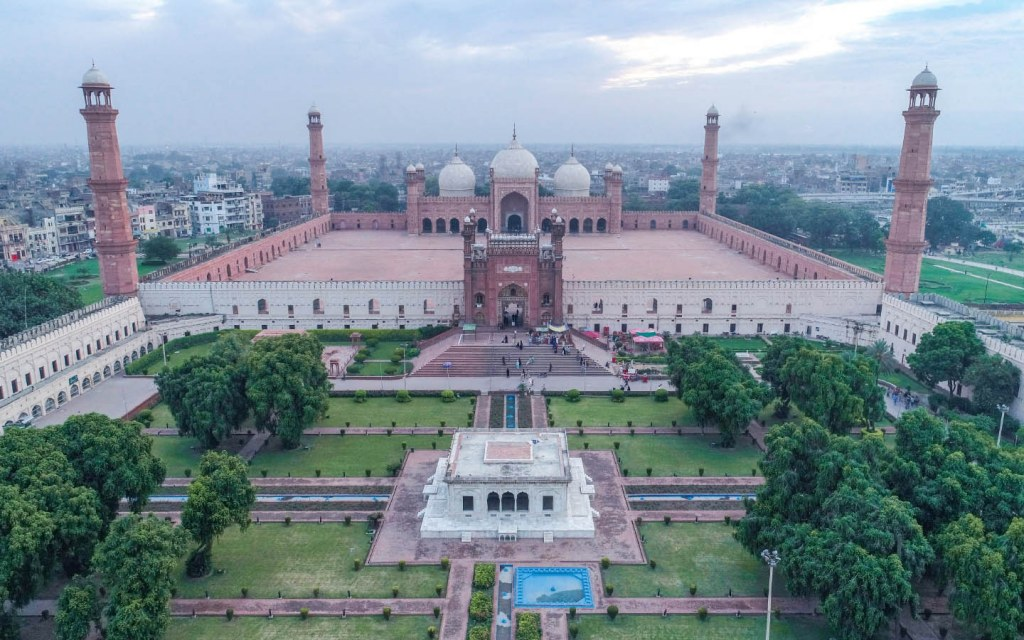 The Badshahi Mosque is located in Hazuri Bagh, Opposite the Lahore Fort