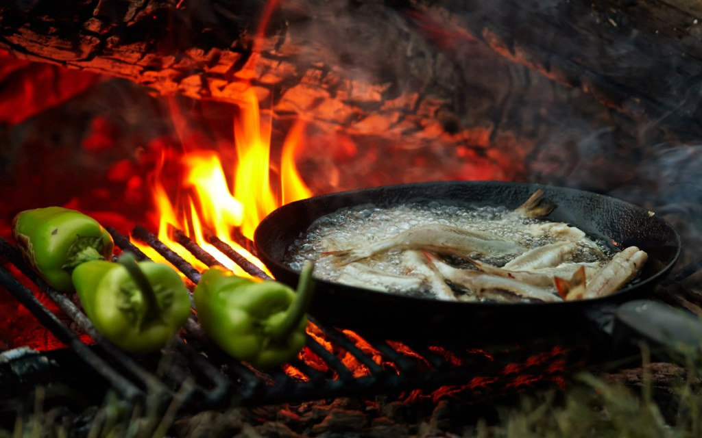 Food cooking on grill