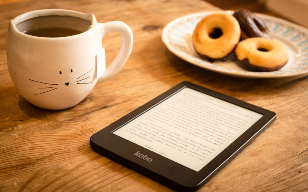 Ebook reader and a plate of donuts
