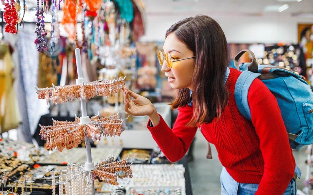 Tourist buying local jewelry