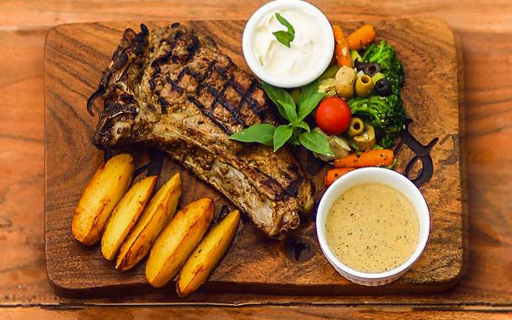 Bovinoes is a famous steak house in DHA Lahore