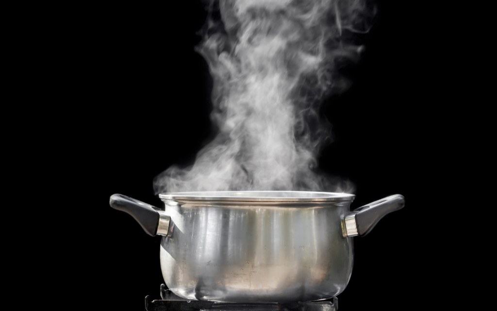 Steam is Coming Out from a Pot