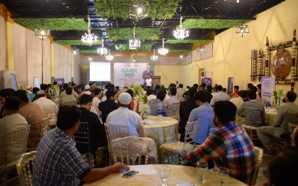 A hall packed with attendees at Business Connect Event in Karachi