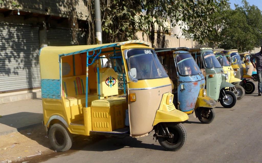 Rickshaws parked at a rickshaw stand