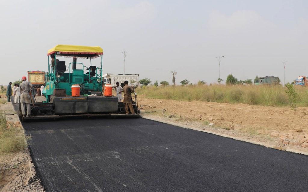 Carpeting of road in Top City 1