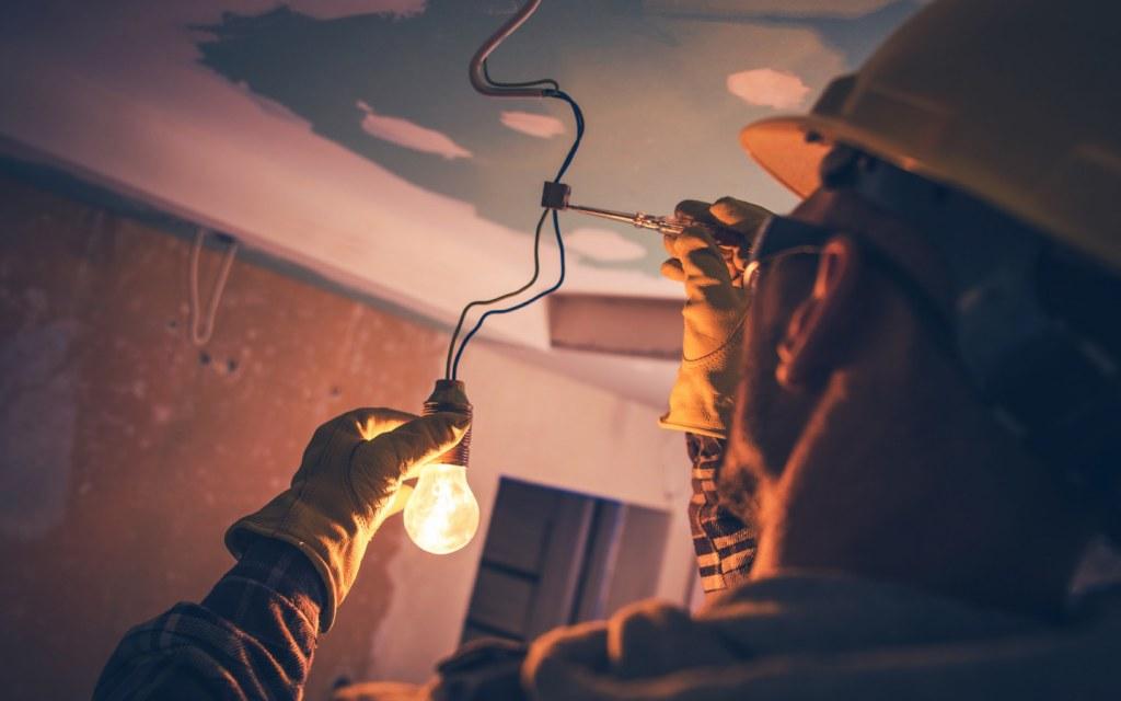 Electrician fixing a light bulb