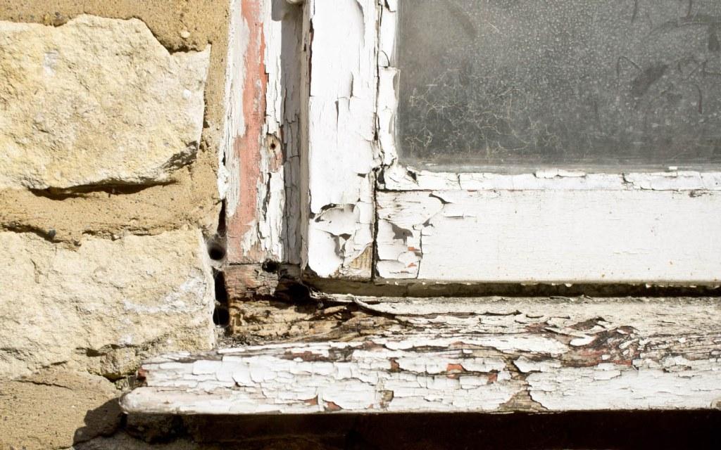 Wooden window frames often need a quicker replacement than metallic ones