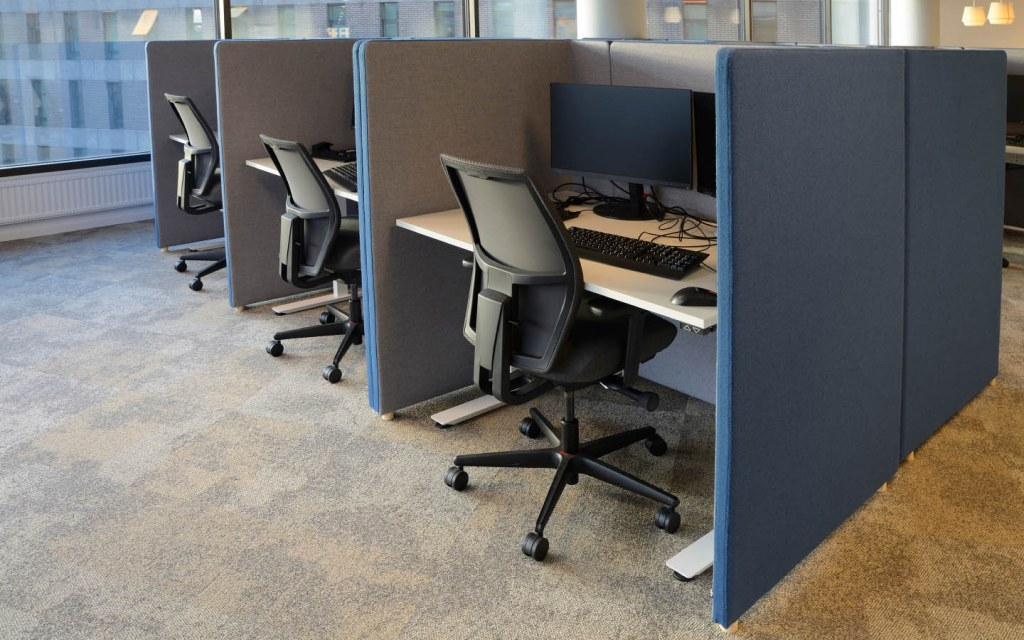 cubicles are a series of partitions with workstations in an office