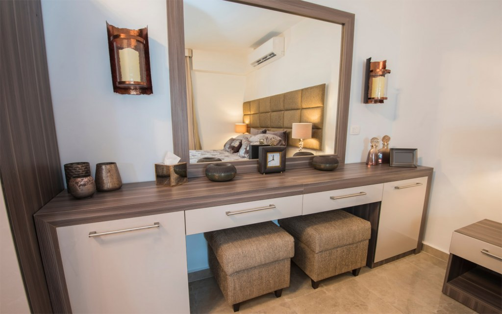 Design the vanity keeping your wall's size and room's space in mind
