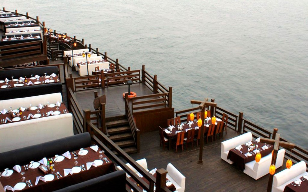 A delightful seating arrangement by the sea is offered at this food street of Karachi