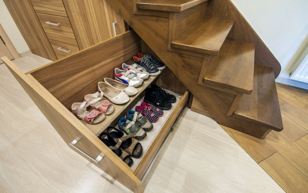 Create more storage space by utilizing the space under the stairs
