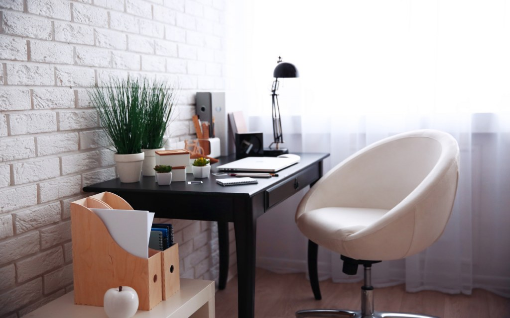 Prop up a desk in an empty corner for your work