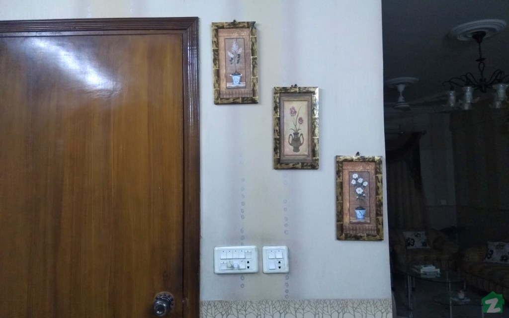 Slim corner walls can be turned into creative photo walls