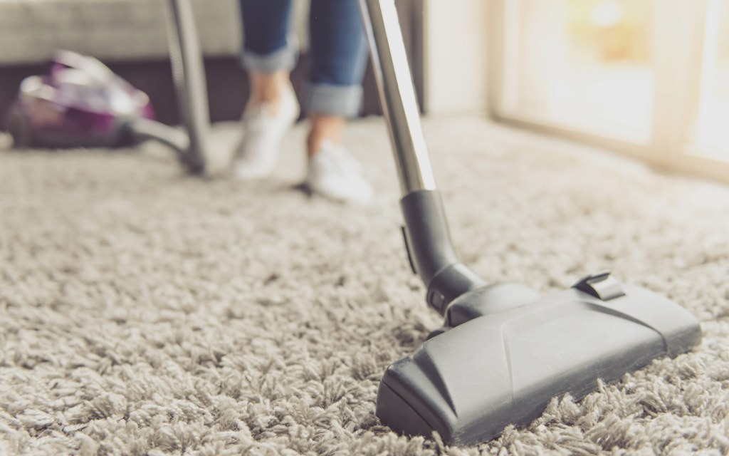 Vacuum cleaner deeply cleans the carpet in the house