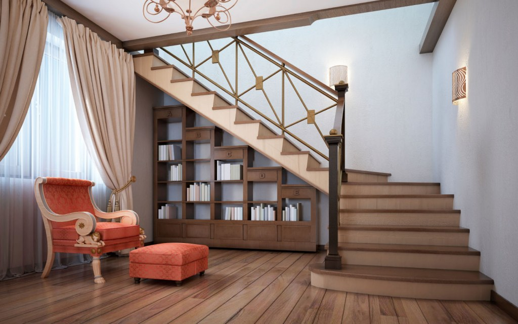 A bookshelf under the stairs as a reading corner