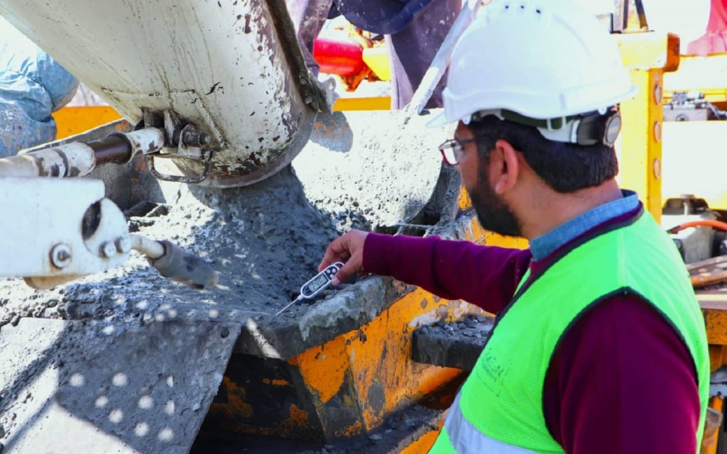 A worker conducts site tests